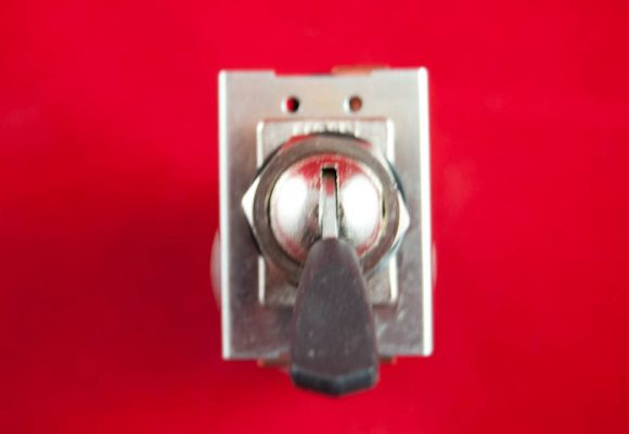 Lighting 'flick' switch for headlamp mounting on late unit machines. Lucas 34419.
