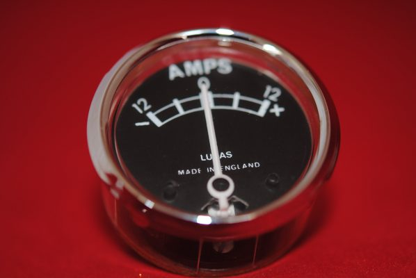 "Ammeter (black face) made by Lucas after market products in England .12V, marked 12 - 12, 1 1/2"" diameter"