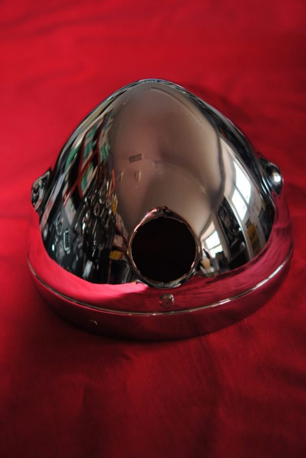 "Triumph motorcycle, chrome head lamp shell with ammeter hole, '60 - '66 (also '67 if hole is cut for light switch) 5/16"" UNF bolt holes. MADE IN ENGLAND."