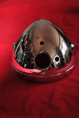 "Triumph Motorcycle, Chrome head lamp shell with ammeter, switch and 2 warning light holes, 67 - 70, 5/16"" UNF holes . MADE IN ENGLAND."