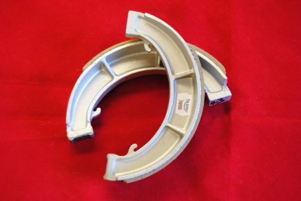 Triumph 8' wide-type floating brake shoes, used with single flanged hub, '65 - '67. per pair.
