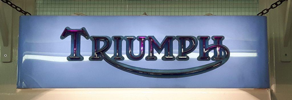 Triumph logo light