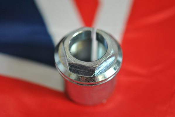 Triumph Fork stem nut  hexagon top with shoulder and damper hole, UNF
